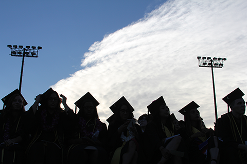 Silhouettes off graduating students.