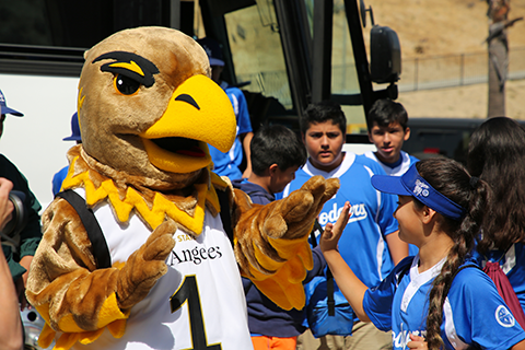 Golden Eagle with students visiting Cal State LA.