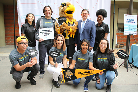 Everytable CEO Sam Polk and Cal State LA Executive VP Jose Gomez with Cal State LA mascot and students.