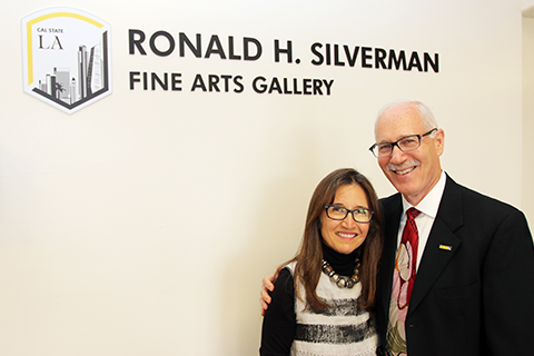Amelia Perez-Silverman and Jeffrey Silverman in front of gallery sign