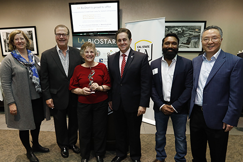 Susan M. Baxter, Robert C. Bishop, Wendie Johnston with the LA BioStar Award, Jose A. Gomez, Raj Perera and Howard Xu