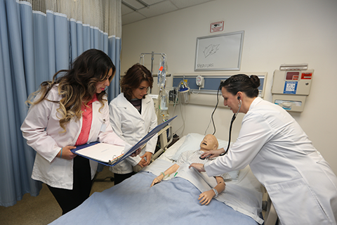 Graduate students in nursing simulation lab.