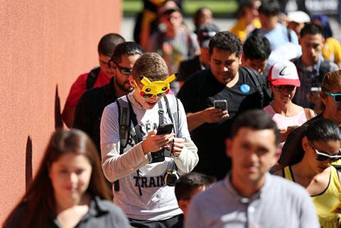 Students participating in the Pokemon GO Health Walk