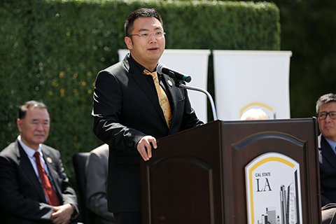 Kevin Xu at College dedication ceremony.