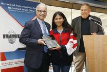 President Covino receives plaque from Hollenbeck Youth Center participant and president at Dodger Stadium Club.