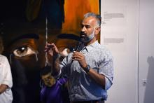 Cal State LA professor and WordsUncaged founder Bidhan Chandra Roy speaks at the exhibit