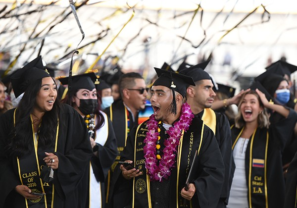 Graduates celebrate their moment as streamers fly above