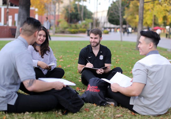 Cal State LA students studying on the lawn