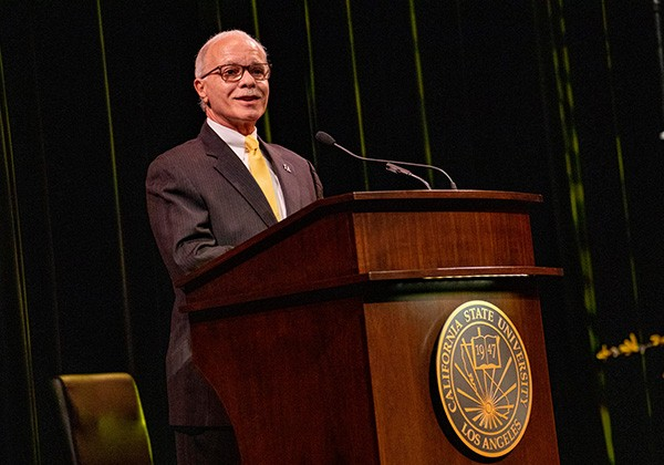 President Covino speaks from a podium during 2021 Fall Convocation