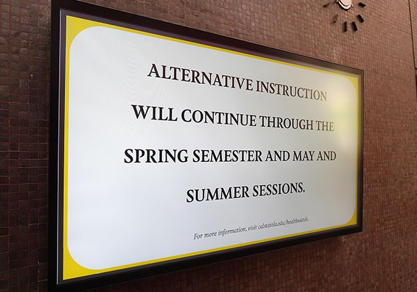 Digital display with message that reads: Alternative instruction will continue through the spring semester and Summer Sessions.