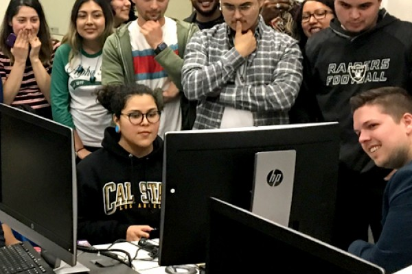 Students looking at a monitor in the classroom