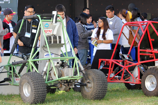 green and red baja cars in crowd