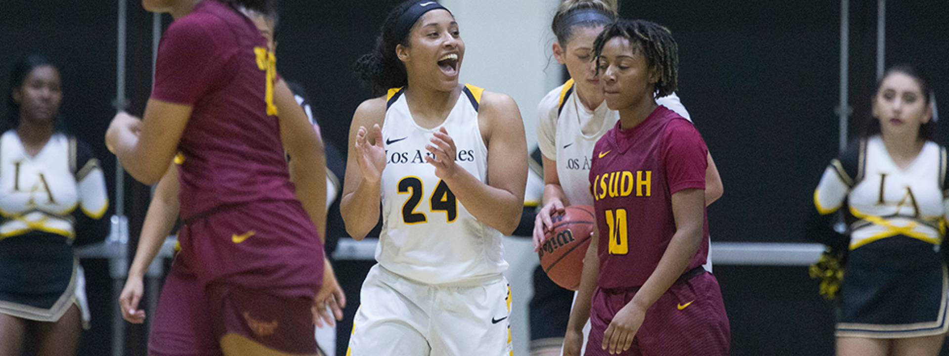 Image of the Cal State LA women's basketball team on the court mid-game.