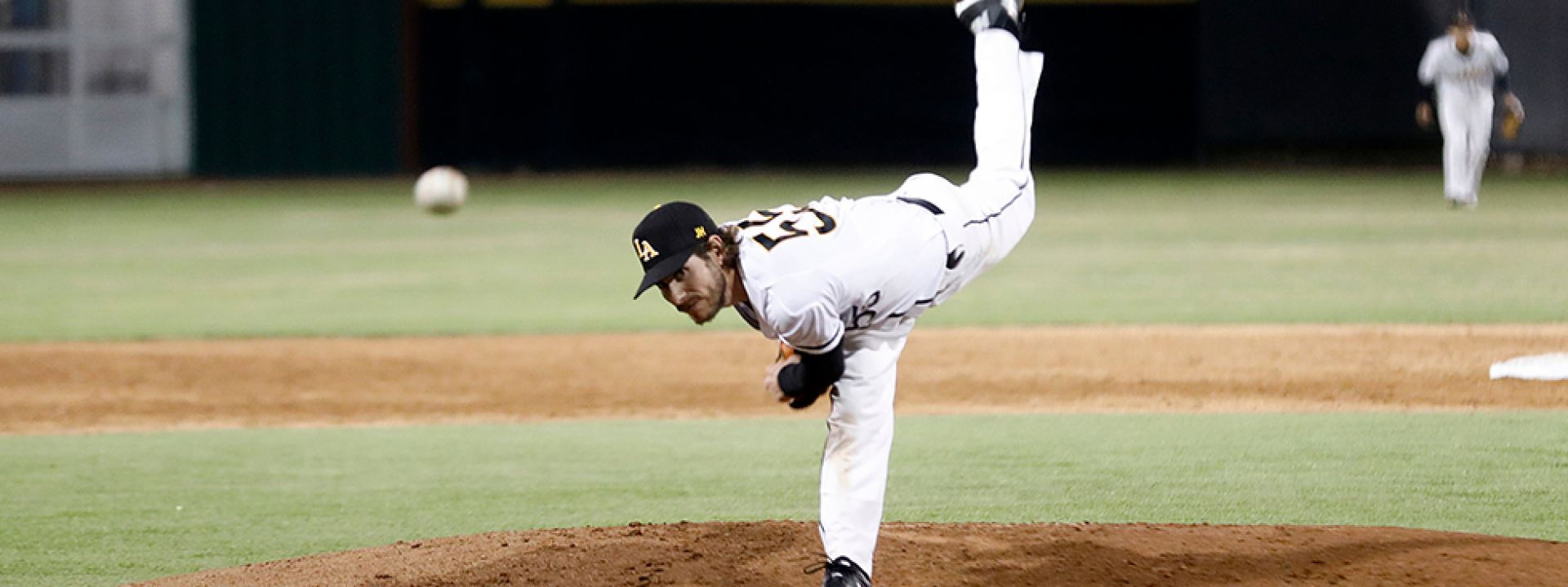 Image of a Cal State LA pitcher on the mound, mid-throw.