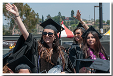 Student wave at the 67th Commencement ceremony.