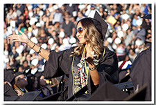 A student stands to receive recognition at the 67th Commencement ceremony.