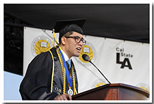 Student Giulio Sanchez speaks at the ceremony for the College of Natural and Social Sciences during the 67th Commencement.