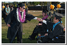 Students shake hands after receiving their diplomas at the 67th Commencement.