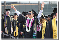A student celebrates at the 67th Commencement ceremony.