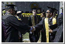 Students shake hands at the 67th Commencement.