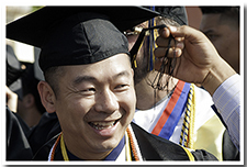 A student gets help with his tassle-turning at the ceremony for the College of Engineering, Computer Science, and Technology during the 67th Commencement.