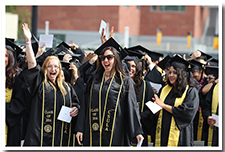 Students cheer during the 67th Commencement