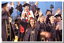 Students cheer after the 67th Commencement.