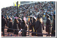 Students enter the Cal State L.A. Athletics Stadium for the 67th Commencement ceremony.
