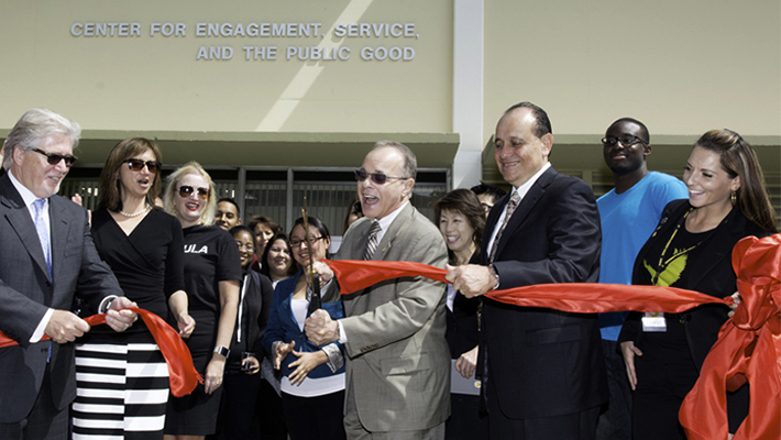 President Covino cuts the ribbon at the grand opening of the Center for Engagement, Service, and the Public Good.