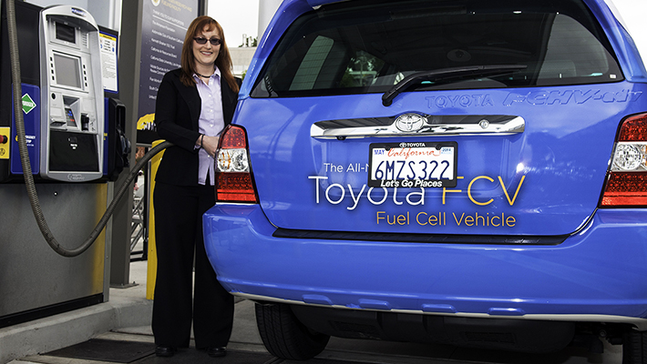 Toyota engineer Andrea Lubawy tests out the pump during the unveiling of the Hydrogen Research and Fueling Station.