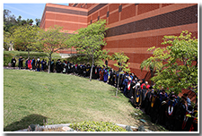 Faculty, dressed in academic regalia, line up for the procession at the Investiture ceremony on May 9.
