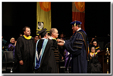 President William A. Covino is invested.