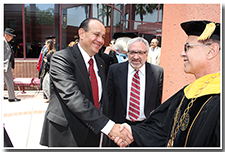 President William A. Covino accepts well-wishes from alumnus Willie Zuniga after the Investiture.