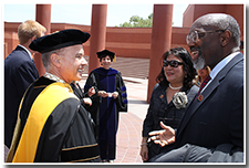 President William A. Covino accepts well-wishes from guests after the Investiture.