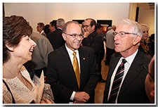 Dr. Debbie Covino, left, and President William A. Covino, center, talk with former president of Fresno State, John Welty, at a pre-reception for the Investiture ceremony on May 9.