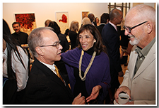 President William A. Covino talks with alumni Rosie and David McNutt at the pre-reception for the Investiture ceremony on May 9.
