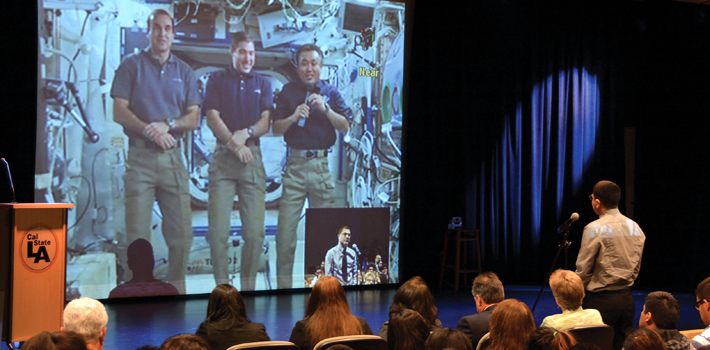 Students talk with NASA astronauts in a intergalactic conference call.