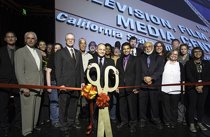 President Covino gets ready to cut the ribbon at the grand opening of the Television, Film and Media Center.