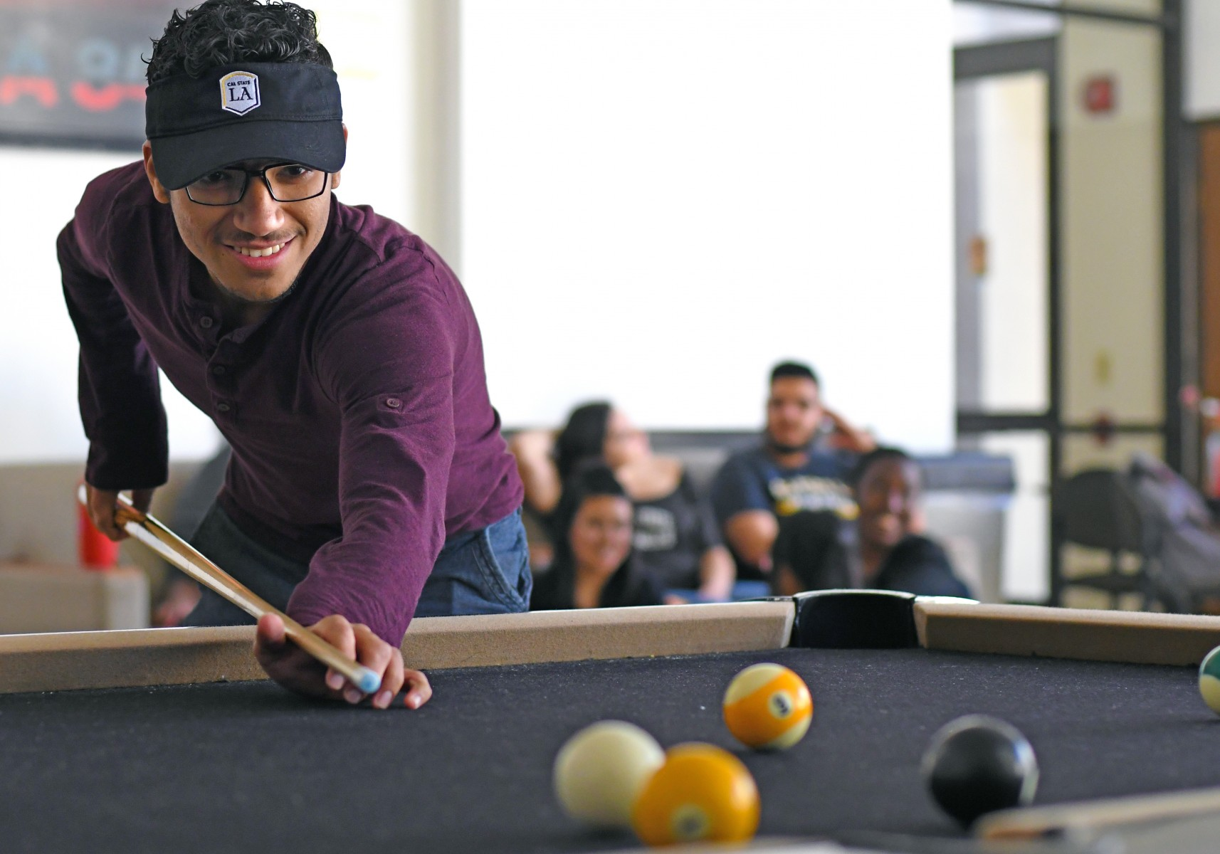Student playing pool.