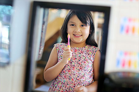 Photo of child with toothbrush