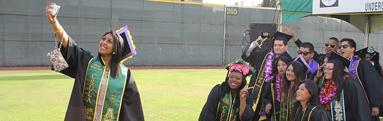 Cal State L.A. Graduate taking selfie with fellow grads