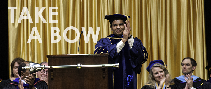 Provost Ashish Vaidya leads applause at the 2013 Honors Convocation