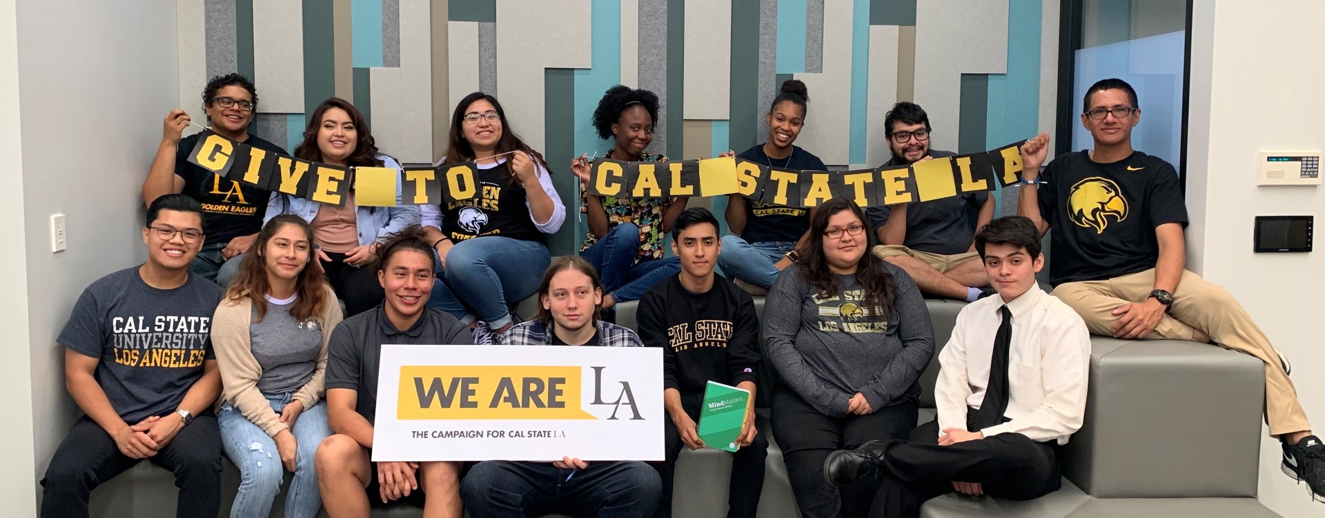 This is an image of Cal State LA's student fundraising team, holding a banner that reads Give to Cal State LA.