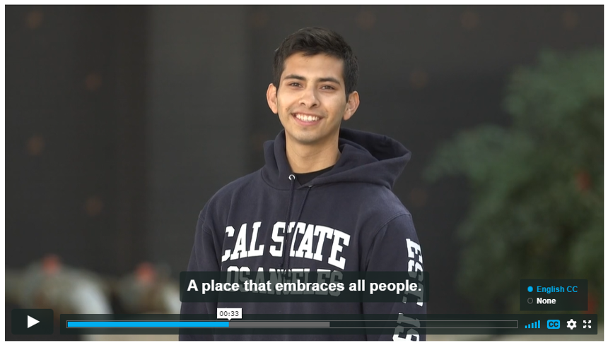 "Screenshot of Campaign for Cal State LA video. Student with Cal State LA sweatshirt, English captions read ""A place that embraces all people"""