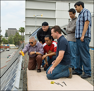 Solar panel team members Cesar Cardenas, Jesse Morales, Edgar Avalos, Jacob Dayneko, Jimmy Hoo and Jeovany Aguilar gauge the output of their panels on top of the Engineering and Technologybuilding. There are two, 77-panel grid systems that will power lab experiments and research, as well as supply energy to a hydrogen fueling station.