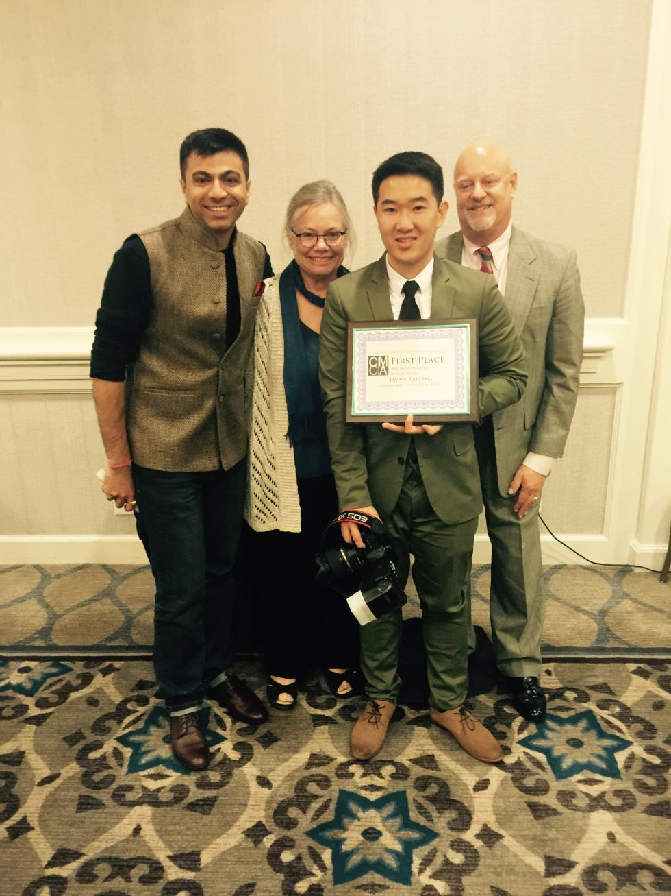 Timmy Truong receiving his award from CCMA